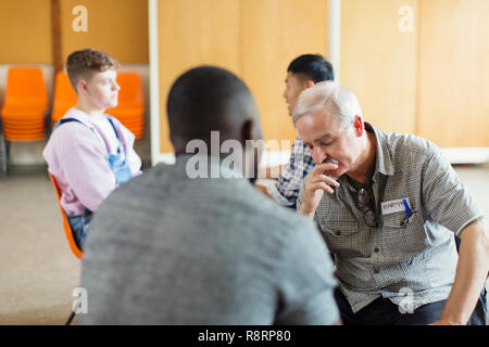 Emotional man in group therapy - Stock Image