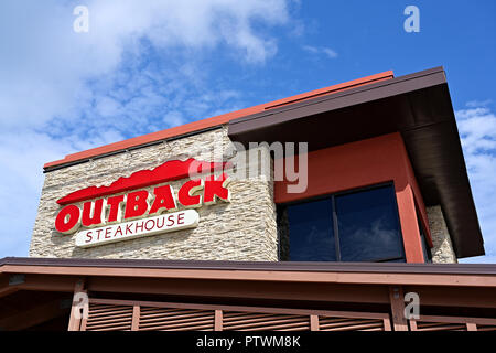 Outback Steakhouse restaurant front exterior sign and corporate logo in Montgomery Alabama, USA. - Stock Image