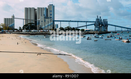 Trafaria, Portugal - Dec 16, 2018: Deep water terminal and silo for grain, derived products and oleaginous products in Trafaria, Portugal - Stock Image