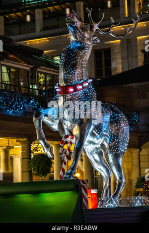 Christmas decorations in the shape of a reindeer in the Covent Garden market in London - Stock Image