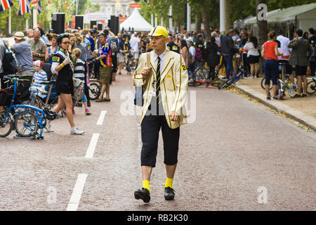A male competitor in a yellow suit with crowd behind him, Brompton World Championships 2018, London, UK - Stock Image