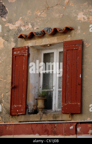 Shuttered windows in the medieval town of Le Castellet, near Toulon, France - Stock Image