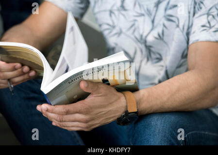Man reading book - Stock Image