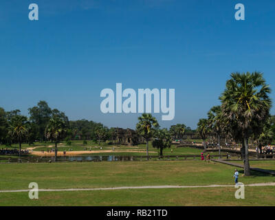 Looking across some of the grounds of magnificent ruins of Angkor Wat Cambodia Asia an architectural masterpiece and largest religious monuments in th - Stock Image
