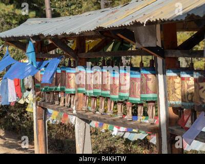 Prayer Wheels on the path to Taktsang Monastery, Bhutan - Stock Image
