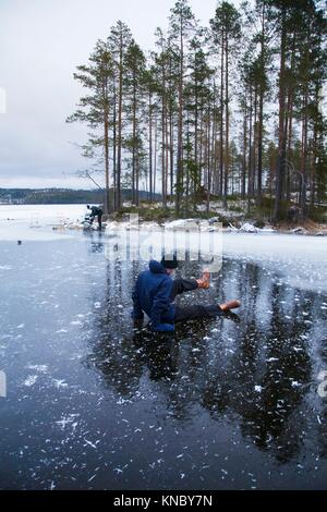 Sitting on thin ice Northern Sweden. - Stock Image