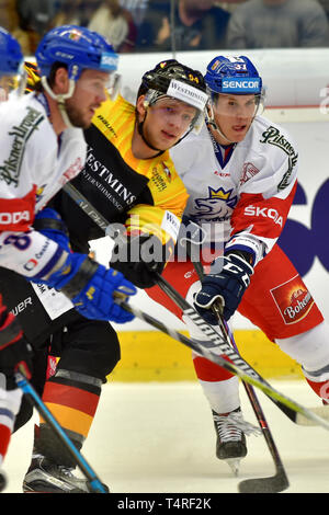 Karlovy Vary, Czech Republic. 18th Apr, 2019. Lean Bergmann of Germany, left, and Tomas Fort of Czech Republic in action during the Euro Hockey Challenge match Czech Republic vs Germany in Karlovy Vary, Czech Republic, April 18, 2019. Credit: Slavomir Kubes/CTK Photo/Alamy Live News - Stock Image