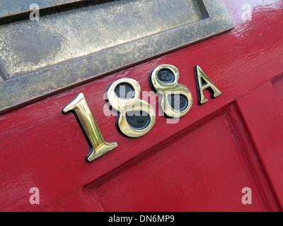 Red door number 118a - Stock Image