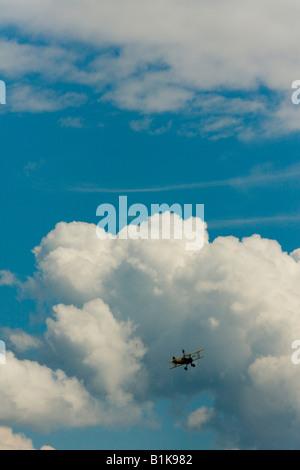 Nostalgic biplane amongst clouds, Airshow Maribor 2008, Slovenia June 15, 2008 - Stock Image