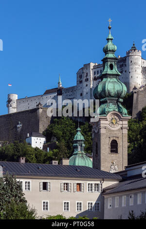 Hohensalzburg Castle above the city of Salzburg in Austria. The Old Town (Altstadt) has one of the best-preserved city centers north of the Alps. It i - Stock Image