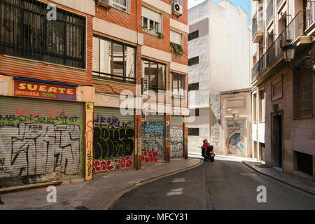 Street scene with motorbike rider in Barrio del Carmen, Valencia, Spain. - Stock Image