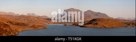 Panorama of Benn Airigh Charr and Loch Kernsary in the evening light, Poolewe, Scotland. - Stock Image