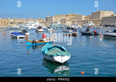 Boats on the Grand harbour in the Three Cities area of Malta - Stock Image
