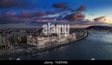 Budapest, Hungary - Aerial panoramic view of the beautiful illuminated Parliament of Hungary with Szechenyi Chain Bridge, Statue of Liberty and colurf - Stock Image