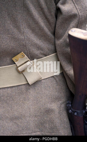 Detail of a member of a living history group dressed as a British World War I soldier - Stock Image