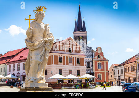Main square of Telc city, a UNESCO World Heritage Site, on a sunny day with blue sky and clouds, South Moravia, Czech Republic. - Stock Image