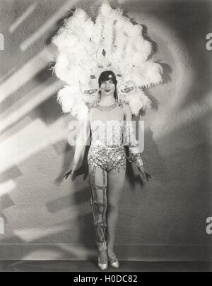 Showgirl in feather headdress - Stock Image