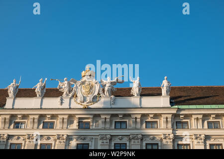 Sculpture and Royal Insignia, Hofburg Imperial Palace, Vienna, Austria - Stock Image