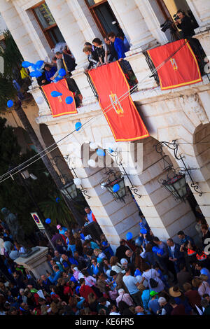 balloons released over the penitents at the Easter Sunday Resurrection Parade in Gandia Spain - Stock Image
