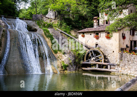 Waterfall with cottage with a water mill - landscape - Stock Image