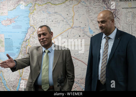Jerusalem, Israel. 2nd July, 2019.  Head of the Palestinian delegation of businessmen to the June 2019 US led economic workshop in Bahrain, ASHRAF AL JABARI (L), and participant ASHRAF AL GHANEM (R), address the press in Jerusalem fearing Palestinian Authority vengance. The PA boycotted the 'Peace to Prosperity' workshop claiming it an attempt to buy off Palestinian political aspirations. Al Jabari, former member of PA security forces, stressed participation in the workshop had no political intentions. Al Ghanem currently resides at an undisclosed location for fear of imminent arrest. Credit: - Stock Image