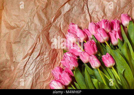 Fresh flower composition, bouquet pink tulips on craft paper background. Valentine, Women's, 8 march, birthday, - Stock Image
