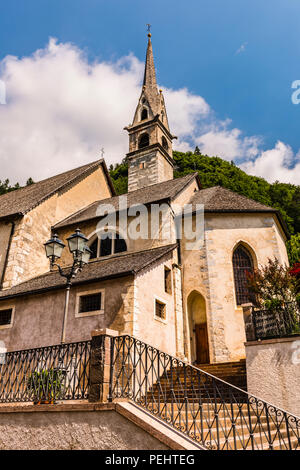 Church in the mountains at Pieve Tesino, Trentino, Italy - Stock Image