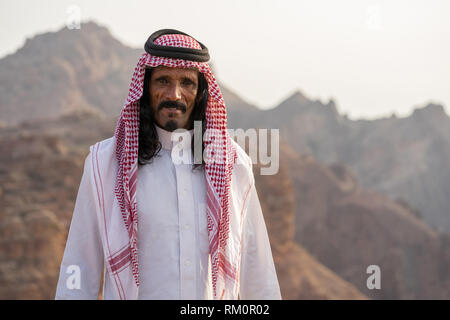 Warmth and hospitality shown through the face of this Bedouin man in the mountains of Jordan near Petra. - Stock Image