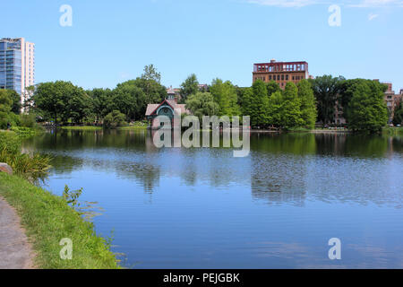 North-west facing view o Harlem Meer in Northern Central Park, Manhattan on JULY 4th, 2017 in New York, USA. - Stock Image