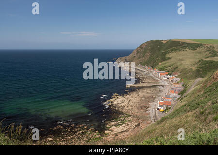 The village of Crovie, Aberdeenshire, Scotland, UK. taken from the surrounding cliff top. - Stock Image