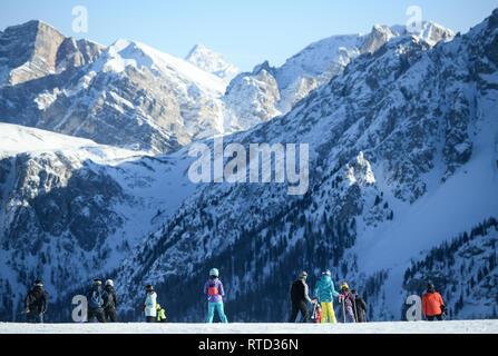Kronplatz, South Tyrol, Italy - February 15, 2019: people enjoy skiing at Kronplatz Plan de Corones ski resort in the snowy Dolomites on a beautiful s - Stock Image