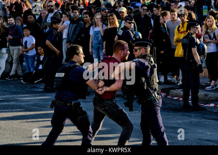 Techno Parade, Place de la Nation, Paris 2017. Police restrain man and is arrested. 23rd September 2017 - Stock Image