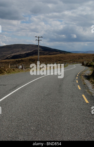 Lonesome Road #42. Remote road through the foothills of mountains - Stock Image