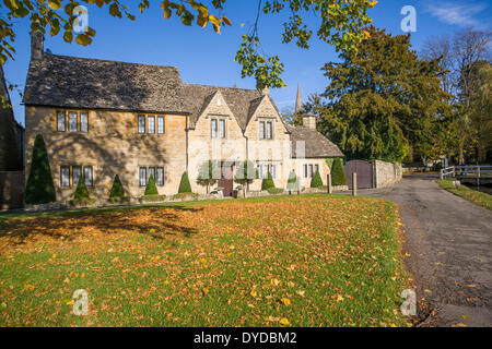 Traditional stone houses at Lower Slaughter in the Cotswolds. - Stock Image