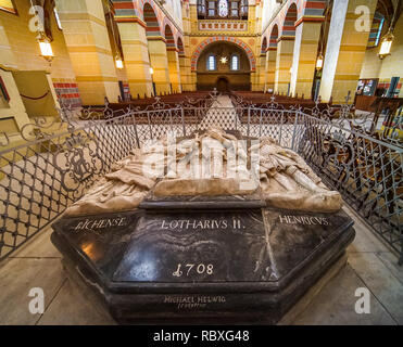 Koenigslutter, Germany, January 3., 2019: Artistic sarcophagi inside the cathedral with a small gate - Stock Image