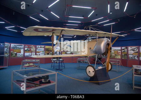 Replica of the Nieuport 11, nicknamed Bébé, a French World War I single seat sesquiplane fighter aircraft at a display in Serbian Aeronautical museum - Stock Image