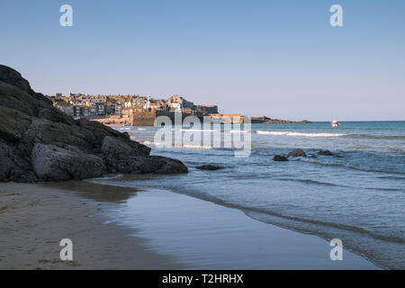 St Ives harbour on a bright sunny March day, viewed from Porthminster Beach, Cornwall, England, UK - Stock Image