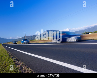 Driving through scenic country setting North Queensland Australia - Stock Image