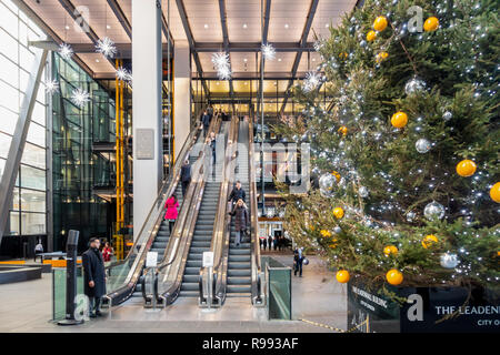 The atrium of the Leadenhall Building (2015) aka 122 Leadenhall Street and The Cheesegrater, with a large decorated Christmas trees and decorative sus - Stock Image