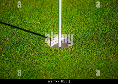 Green golf hole on a sunny day - Stock Image