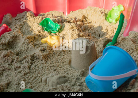children playing in the sand - Stock Image