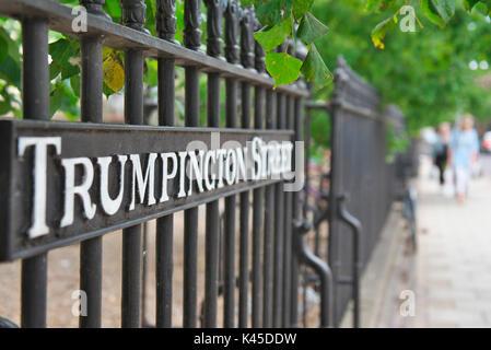 Trumpington Street sign in Cambridge city centre along the black railings - Stock Image