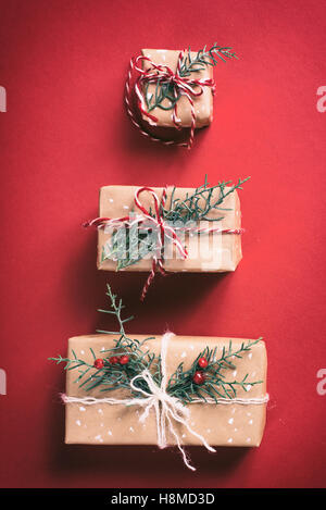 Christmas gift boxes on red background - Stock Image