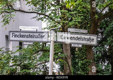 Road sign. Finckensteinallee & Karwendelstrasse street sign in Berlin-Lichterfelde - Stock Image