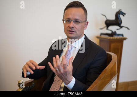 (190423) -- BUDAPEST, April 23, 2019 (Xinhua) -- Hungarian Minister of Foreign Affairs and Trade Peter Szijjarto speaks during an interview with Xinhua in Budapest, Hungary, April 16, 2019. Hungary is proud to be the first European country to sign an intergovernmental cooperation agreement with China over the Belt and Road Initiative (BRI), Hungarian Minister of Foreign Affairs and Trade Peter Szijjarto said.    The BRI 'is very significant from the perspective of Europe, because it is Europe's interest to be able to build a good and effective cooperation with China,' Szijjarto told Xinhua in  - Stock Image