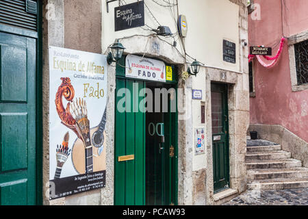 27 February 2018: Lisbon, Portugal - Restaurant advertising Fado, the traditional Portuguese musical genre, in the Alfama District. - Stock Image