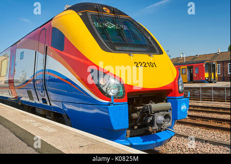 The front streamlined end of a class 222 passenger train, in striking East Midlands Trains colours - Stock Image