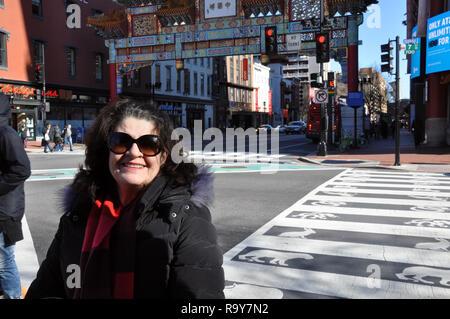 Brazilian Woman Shopping in Chinatown District, Washington DC - Stock Image