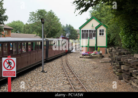 The No. 9 'Mark Timothy' narrow gauge steam locomotive, pulling out of the Bure Valley Railway station in Aylsham, Norfolk. - Stock Image
