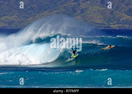 Surfing action at Windmills, Maui, Hawaii. - Stock Image